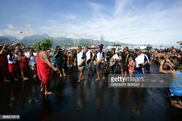 Members of the crew of the Hawaiian canoe Hokule'a are welcome as they arrive in the Mavai Bay in Tahiti on April 14 2017 It is the third time than...