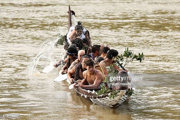 Members of the crew rest their paddles after paddling with Prince Harry on the Whanganui River during a visit to Putiki Marae on May 14 2015 in...