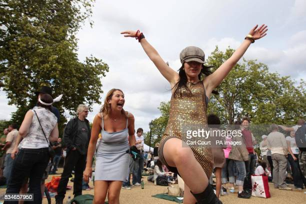 Members of the crowd enjoy themselves during the Subway Picnic Rocks festival on Clapham Common south London