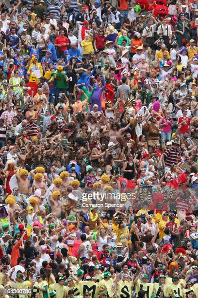 Members of the crowd in fancy dress dance during day two of the 2013 Hong Kong Sevens at Hong Kong Stadium on March 23 2013 in So Kon Po Hong Kong