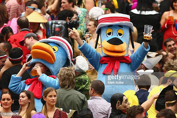 Members of the crowd in fancy dress enjoy the atmosphere in the south stand during day two of the 2013 Hong Kong Sevens at Hong Kong Stadium on March...