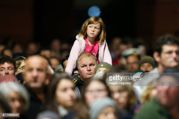 Members of the crowd look on during Anzac Day dawn service at Pukeahu National War Memorial Park on April 25 2017 in Wellington New Zealand In 1916...