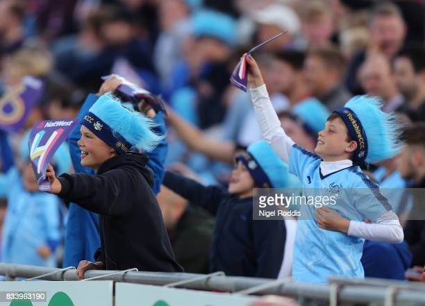 Members of the crowd react during the NatWest T20 Blast at Headingley on August 17 2017 in Leeds England