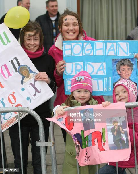 Members of the crown watch as X Factor finalist Eoghan Quigg makes a triumphant opentop bus return to his home town Dungiven in Co Londonderry