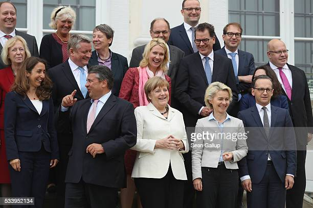 Members of the current German government including German Chancellor Angela Merkel arrive to pose for a group photo during a break while meeting at...
