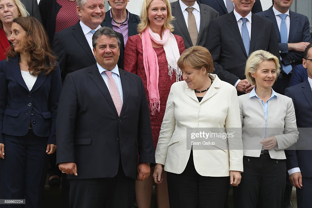 Members of the current German government, including German Chancellor <a gi-track='captionPersonalityLinkClicked' href=/galleries/search?phrase=Angela+Merkel&family=editorial&specificpeople=202161 ng-click='$event.stopPropagation()'>Angela Merkel</a> (C-R, in white), and Vice Chancellor and Economy and Energy Minister <a gi-track='captionPersonalityLinkClicked' href=/galleries/search?phrase=Sigmar+Gabriel&family=editorial&specificpeople=543927 ng-click='$event.stopPropagation()'>Sigmar Gabriel</a> (C-L) arrive to pose for a group photo during a break while meeting at Schloss Meseberg palace on May 24, 2016 near Gransee, Germany. The government cabinet is meeting at Schloss Meseberg for a two-day retreat to principally discuss Germany's digital future.