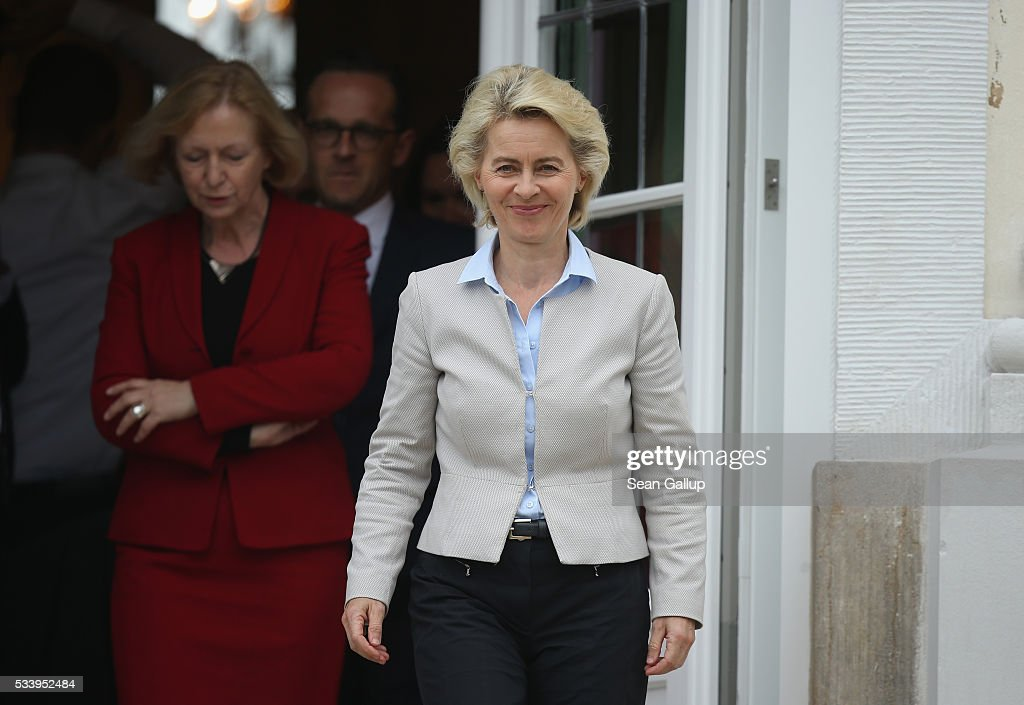 Members of the current German government, including German Defense Minister <a gi-track='captionPersonalityLinkClicked' href=/galleries/search?phrase=Ursula+von+der+Leyen&family=editorial&specificpeople=4249207 ng-click='$event.stopPropagation()'>Ursula von der Leyen</a> (C, in white), arrive to pose for a group photo during a break while meeting at Schloss Meseberg palace on May 24, 2016 near Gransee, Germany. The government cabinet is meeting at Schloss Meseberg for a two-day retreat to principally discuss Germany's digital future.