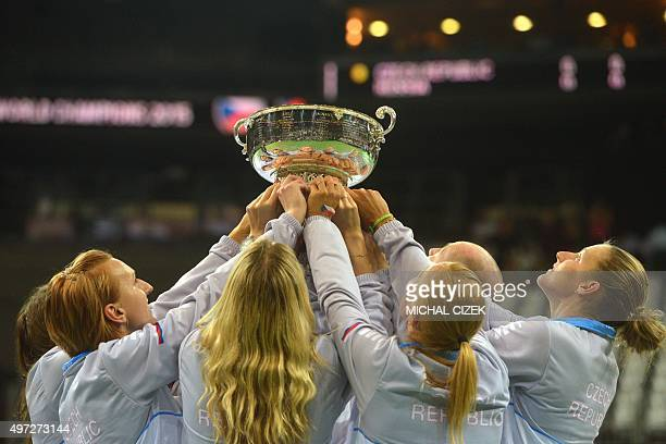 Members of the Czech Fed Cup Tennis team celebrate with the trophy of the International Tennis Federation Fed Cup after the International Tennis...