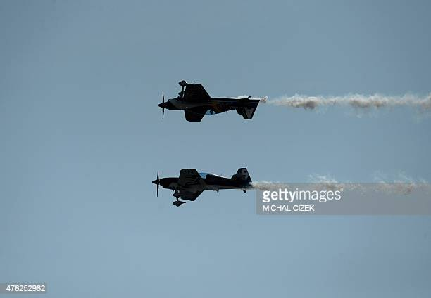 Members of The Czech Flying Bulls aerobatics team perform in their XA 42 planes during the 25th ''Aviation fair'' airshow at Pardubice airpot in...