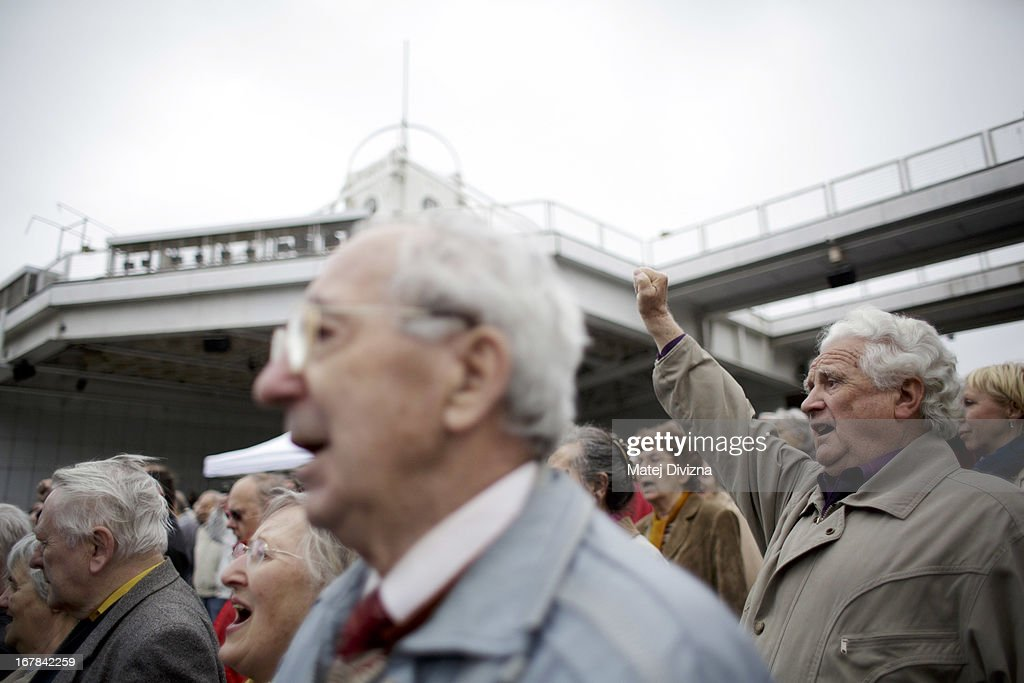 Members of the Czech opposition Communist (KSCM) party sing the 'International', the most famous communist song, as they celebrate May Day on May 1, 2013 in Prague, Czech Republic. In addition to celebrations across the globe of the beginning of spring throughout the world, workers are gathering in city centers to annually vent their grievances and support their worker's unions.
