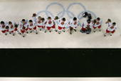 Members of the Czech Republic hockey team line up after receiving the bronze medal after their 30 win against Russia during Day 15 of the Turin 2006...