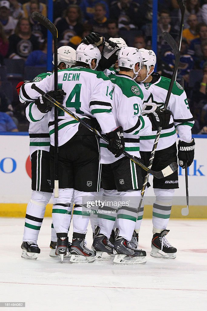 Members of the Dallas Stars celebrate a goal scored against the St. Louis Blues during a preseason at the Scottrade Center on September 21, 2013 in St. Louis, Missouri.