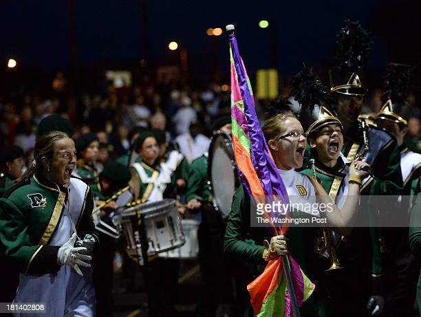 Members of the Damascus High School marching band cheer for the Swarmin' Hornets during halftime of the game between Quince Orchard High School and...