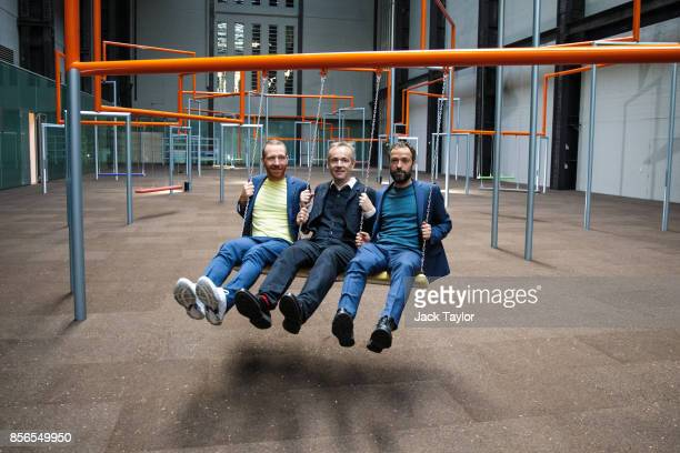 Members of the Danish collective SUPERFLEX Jakob Fenger Rasmus Nielsen and Bjornstjerne Christiansen pose in 'One Two Three Swing' their new Turbine...