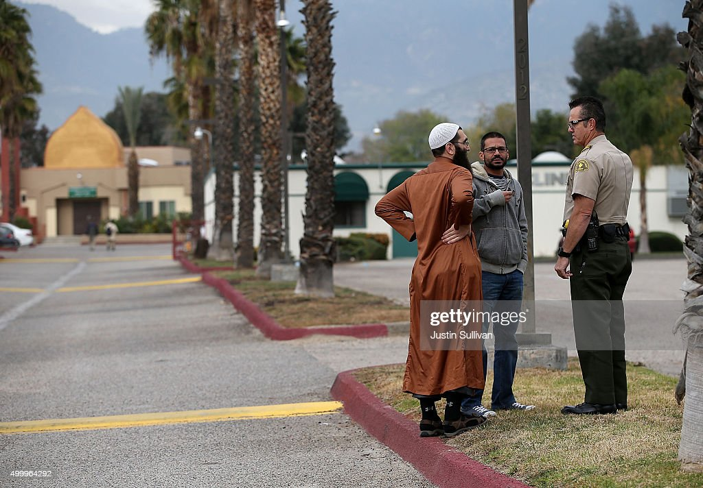 Members of the DarAlUloom AlIslamiyah of America mosque where shooting suspect Syed Farook used to attend prayer services talk with a San Bernardino...