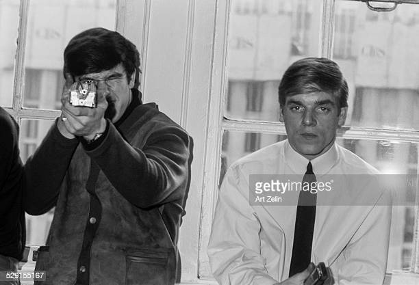 Members of the Dave Clark Five at the Warwick Hotel 1965 Person on the right is aiming an instrument at the photographer as if to shoot New York