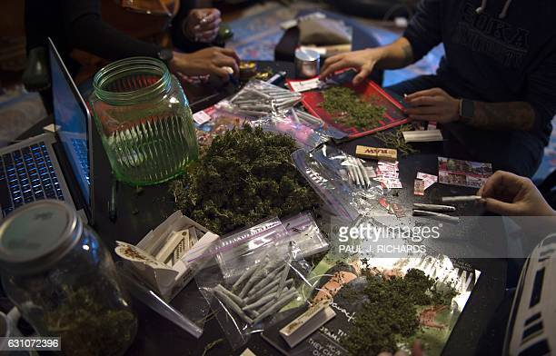 Members of the DC Marijuana Coalition that plan on handing out approximately 4200 joints of legally grown cannabis on January 20 twist up joints on...