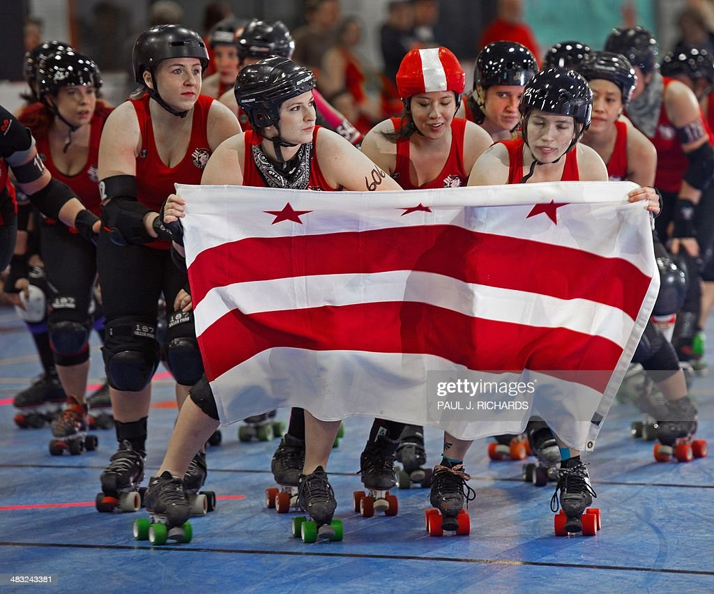Roller skates ottawa - Members Of The Dc Rollergirls Skate With A Washington Dc Flag As They Are Introduced To The Crowd As They Prepare To Take On The Rideau Valley Vixens From