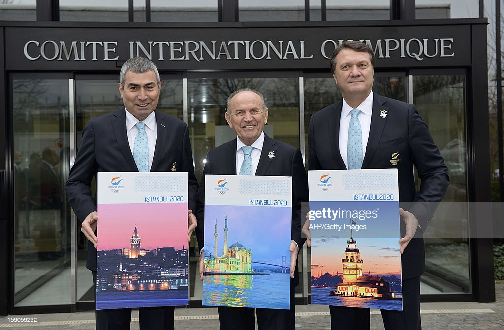 Members of the delegation of Istanbul bid (L to R) IOC member and NOC President, Prof. Ugur Erdener, Major of Istanbul, Kadir Topbas and Bid Committie Leader, Hasan Arat, pose with the candidature files prior to the hand over on January 7, 2013 at the headquarters of the International Olympic Committee in Lausanne. The three candidate cities, Istanbul, Madrid and Tokyo to host the 2020 Olympics take a huge step on the road to who will be designated the winner in Buenos Aires on September 7 when they present their candidature files to the International Olympic Committee on Monday in Lausanne.