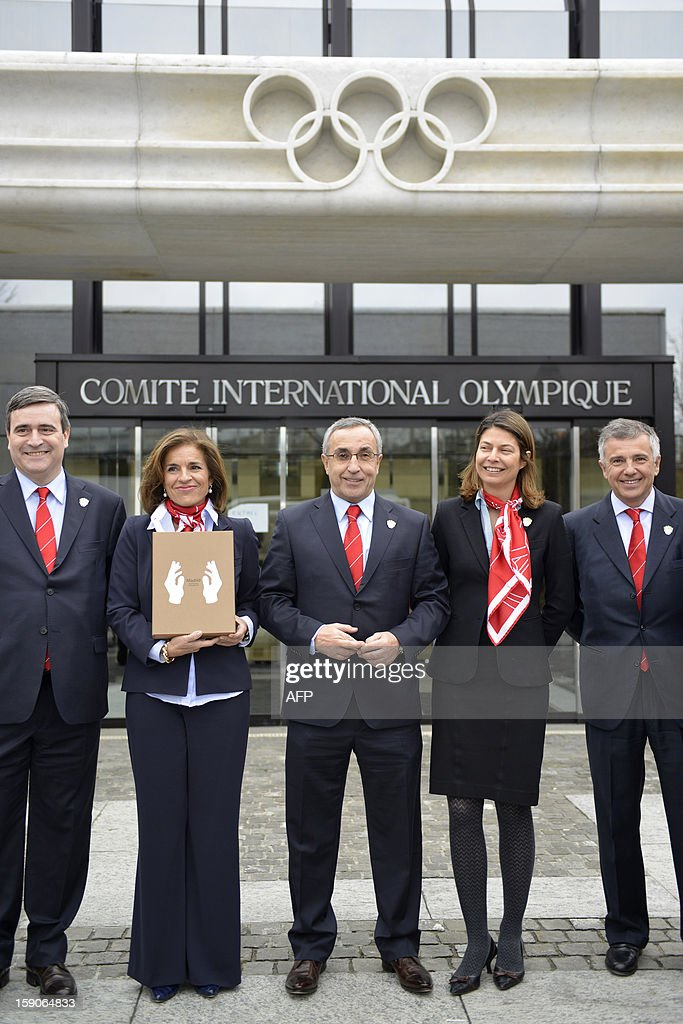 Members of the delegation of Madrid bid (L to R) Miguel Cardenal, President of Council of Sport, Ana Botella, Mayor of Madrid, Alejandro Blanco, CEO and Lucia Figar, City Sport Minister of Madrid, pose with the candidature files prior to the hand over on January 7, 2013 at the headquarters of the International Olympic Committee in Lausanne. The three candidates cities, Istanbul, Madrid and Tokyo to host the 2020 Olympics taken a huge step on the road to who will be designated the winner in Buenos Aires on September 7 when they present their candidature files to the International Olympic Committee on Monday in Lausanne.