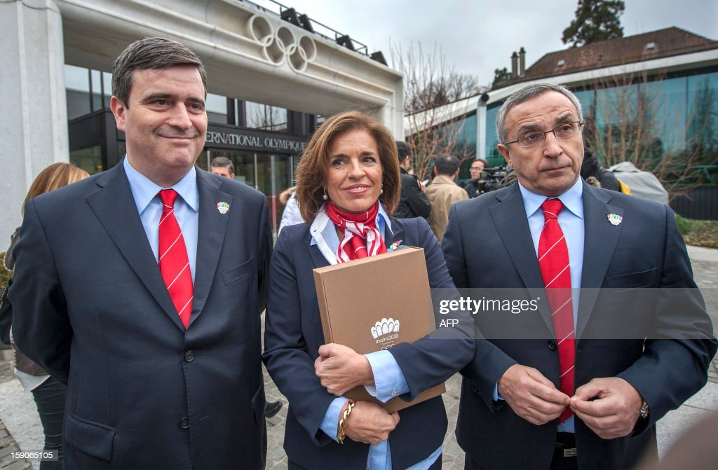 Members of the delegation of Madrid bid (L to R) Miguel Cardenal, president of Council of SportAna Botella, Mayor of Madrid and Alejandro Blanco, IOC member pose , Ana Botella, Mayor of Madrid and Alejandro Blanco pose with the candidature files prior to the hand over, on January 7, 2013 at the headquarters of the International Olympic Committee in Lausanne. The three candidate cities, Istanbul, Madrid and Tokyo to host the 2020 Olympics take a huge step on the road to who will be designated the winner in Buenos Aires on September 7 when they present their candidature files to the International Olympic Committee on Monday in Lausanne.