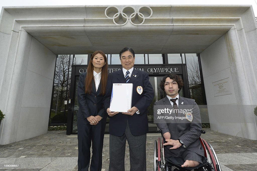 Members of the delegation of Tokyo bid (L to R) Four-time Olympian and 2011 FIFA Ballon d'Or winner Homare Sawa, Tokyo 2020 CEO Masato Mizuno and Paralympic champion in swimming Takayuki Suzuki, pose with the candidature files prior to the hand over on January 7, 2013 at the headquarters of the International Olympic Committee in Lausanne. The three candidates cities, Istanbul, Madrid and Tokyo to host the 2020 Olympics take a huge step on the road to who will be designated the winner in Buenos Aires on September 7 when they present their candidature files to the International Olympic Committee on Monday in Lausanne.AFP PHOTO / SEBASTIEN FEVAL