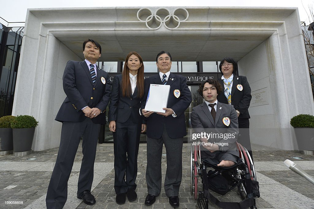 Members of the delegation of Tokyo bid (L to R) Yasuhiro Nakamori, director of Japanese Olympic Committie, ,four-time Olympian and 2011 FIFA Ballon d'Or winner Homare Sawa, Tokyo 2020 CEO Masato Mizuno, Paralympic champion in swimming Takayuki Suzuki and Senior Director for planning Tokyo metropolitan Government Katsura Enyo, pose with the candidature files prior to the hand over on January 7, 2013 at the headquarters of the International Olympic Committee in Lausanne. The three candidates cities, Istanbul, Madrid and Tokyo to host the 2020 Olympics take a huge step on the road to who will be designated the winner in Buenos Aires on September 7 when they present their candidature files to the International Olympic Committee on Monday in Lausanne.