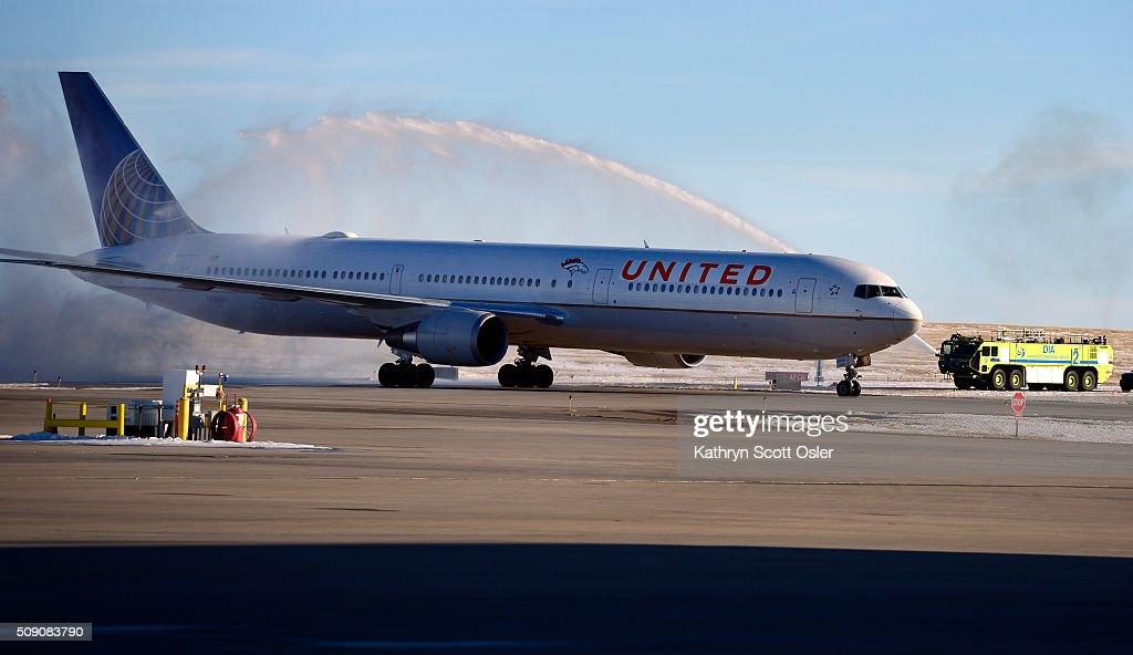 Members of the Denver Broncos football team arrive home at Denver international Airport on Monday, Feb. 8, 2016.