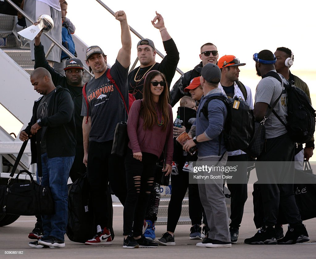 Members of the Denver Broncos football team arrive home at Denver international Airport on Monday, Feb. 8, 2016.