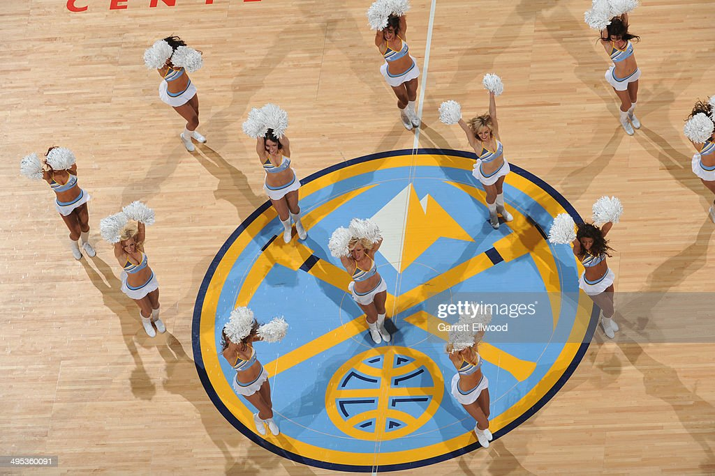 Members of the Denver Nuggets dance team perform during the game against the Milwaukee Bucks on February 5, 2014 at the Pepsi Center in Denver, Colorado.