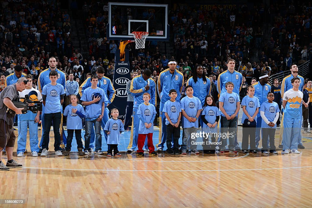 Members of the Denver Nuggets listen to the The Star-Spangled Banner prior to the game against the Minnesota Timberwolves on January 3, 2013 at the Pepsi Center in Denver, Colorado.