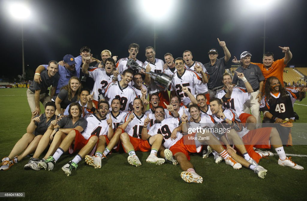 Members of the Denver Outlaws pose for a team picture with the Steinfeld Trophy after winning the 2014 Major League Lacrosse Championship Game against the Rochester Rattlers at Fifth Third Bank Stadium on August 23, 2014 in Kennesaw, Georgia.