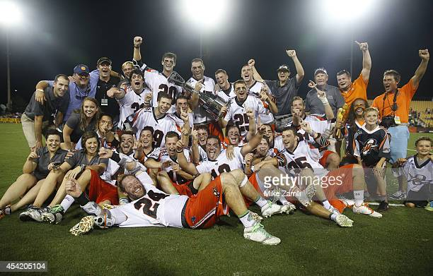 Members of the Denver Outlaws pose for a team picture with the Steinfeld Trophy after winning the 2014 Major League Lacrosse Championship Game...