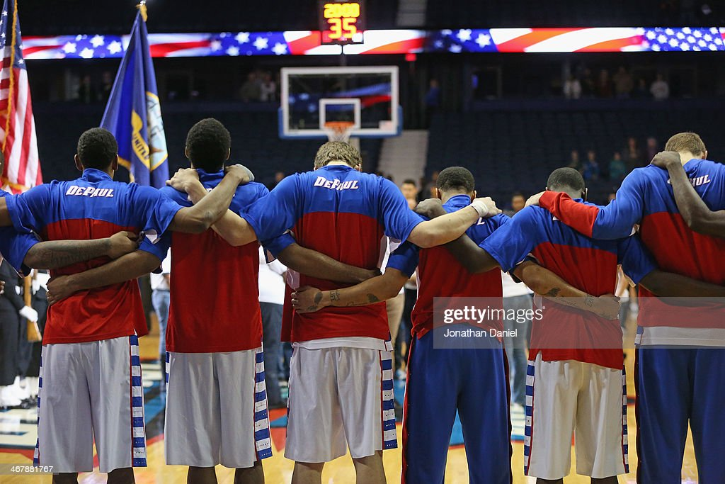 Members of the DePaul Blue Demons stand during the National Anthem before a game against the Georgetown Hoyas at the Allstate Arena on February 3, 2014 in Rosemont, Illinois. Georgetown defeated DePaul 71-59.