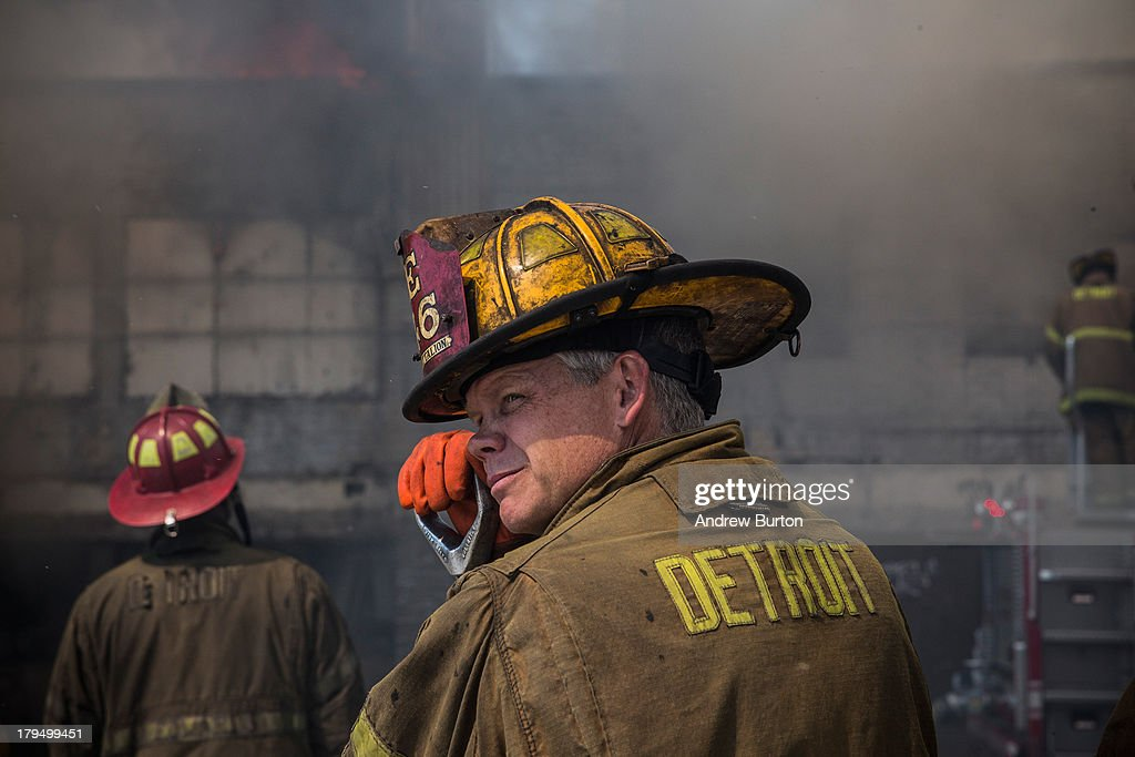Members of the Detroit Fire Department fight a two-alarm fire that broke out in an abandoned building on September 4, 2013 in the Six Mile Gratiot neighborhood of Detroit, Michigan. Detroit has an estimated 78,000 abandoned buildings across its 142 square miles. Last month the city declared bankruptcy, the largest municipality to ever do so in the United States.