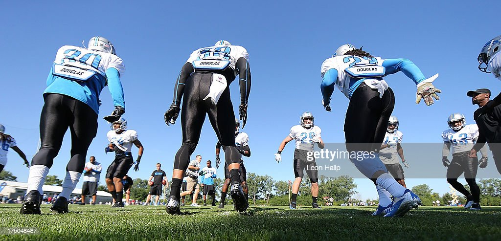 Members of the Detroit Lions secondary run thru the workout drills during training camp on July 30, 2013 in Allen Park, Michigan.