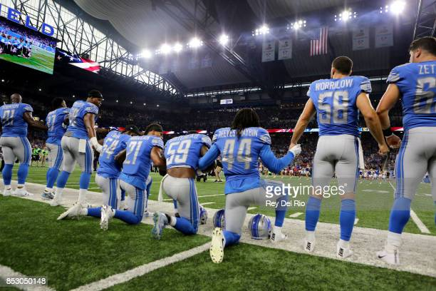 Members of the Detroit Lions take a knee during the playing of the national anthem prior to the start of the game against the Atlanta Falcons at Ford...