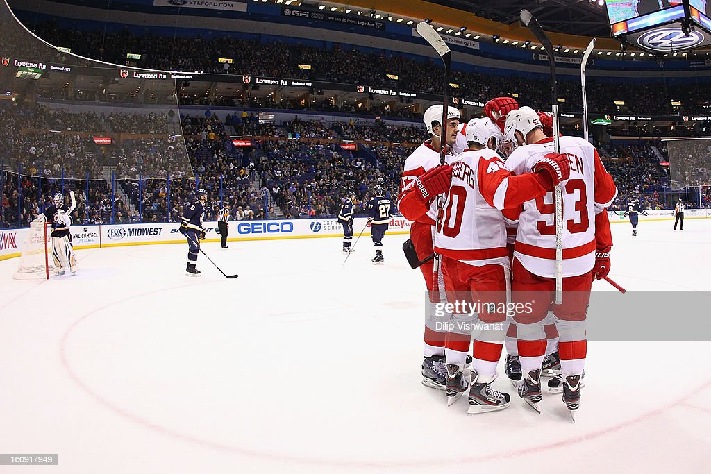Members of the Detroit Red Wings celebrate a goal against the St. Louis Blues at the Scottrade Center on February 7, 2013 in St. Louis, Missouri.