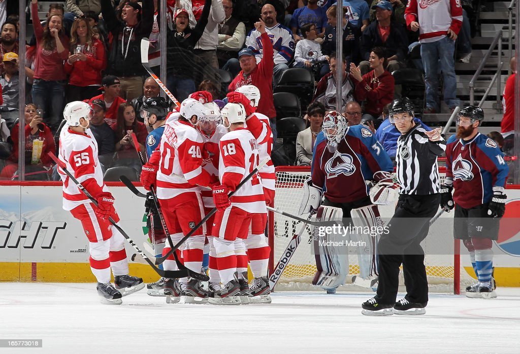 Members of the Detroit Red Wings celebrate a Pavel Datsyuk goal against the Colorado Avalanche at the Pepsi Center on April 5, 2013 in Denver, Colorado.