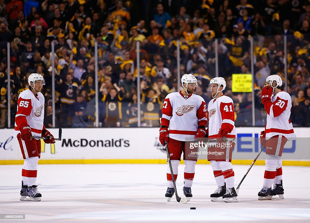 Members of the Detroit Red Wings including <a gi-track='captionPersonalityLinkClicked' href=/galleries/search?phrase=Kyle+Quincey&family=editorial&specificpeople=2234340 ng-click='$event.stopPropagation()'>Kyle Quincey</a> #27 and <a gi-track='captionPersonalityLinkClicked' href=/galleries/search?phrase=Luke+Glendening&family=editorial&specificpeople=5650380 ng-click='$event.stopPropagation()'>Luke Glendening</a> #41 stand together after giving up a goal in the second period against the Boston Bruins in Game Five of the First Round of the 2014 NHL Stanley Cup Playoffs at TD Garden on April 26, 2014 in Boston, Massachusetts.