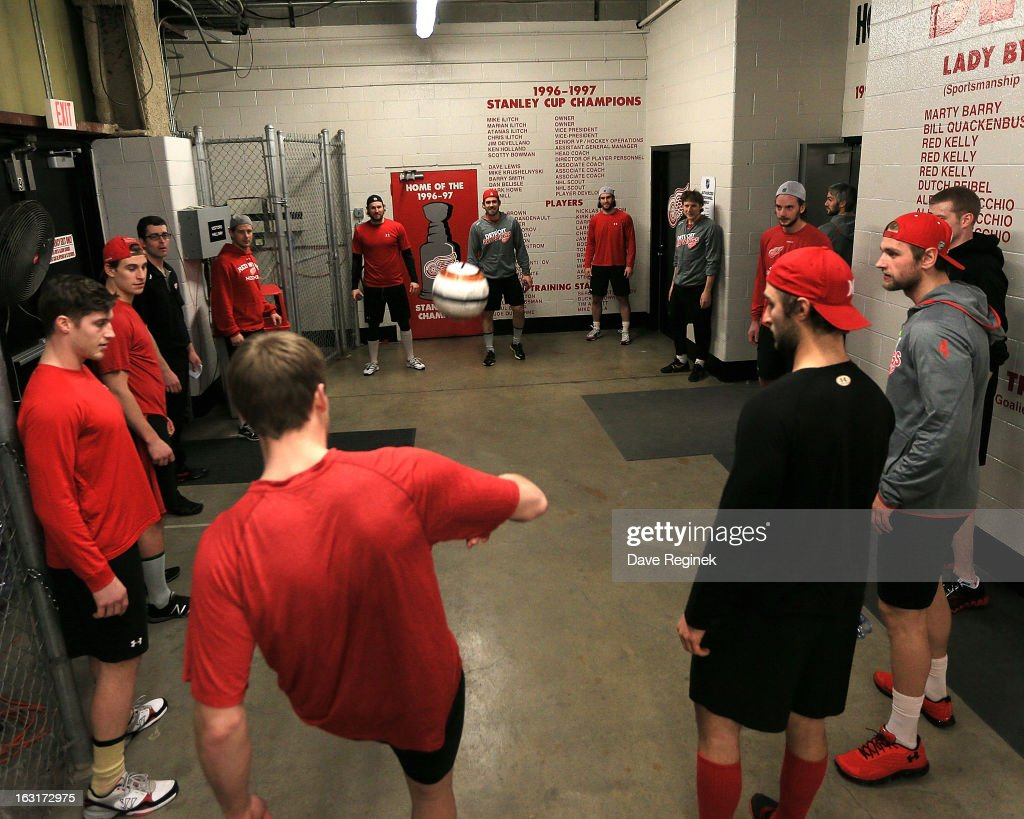 Members of the Detroit Red Wings kick around a soccer ball before a NHL game against the Colorado Avalanche at Joe Louis Arena on March 5, 2013 in Detroit, Michigan.
