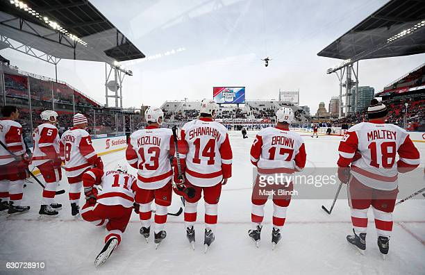 Members of the Detroit Red Wings line up for the national anthem at 2017 Rogers NHL Centennial Classic Alumni game between the Detroit Red Wings and...