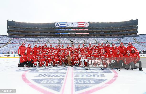 Members of the Detroit Red Wings pose for a team photo during the 2014 Bridgestone NHL Winter Classic team practice session on December 31 2013 at...