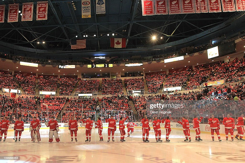 Members of the Detroit Red Wings salute the fans during pre-game ceramonies before an NHL game against the Dallas Stars at Joe Louis Arena on January 22, 2013 in Detroit, Michigan. Dallas won 2-1