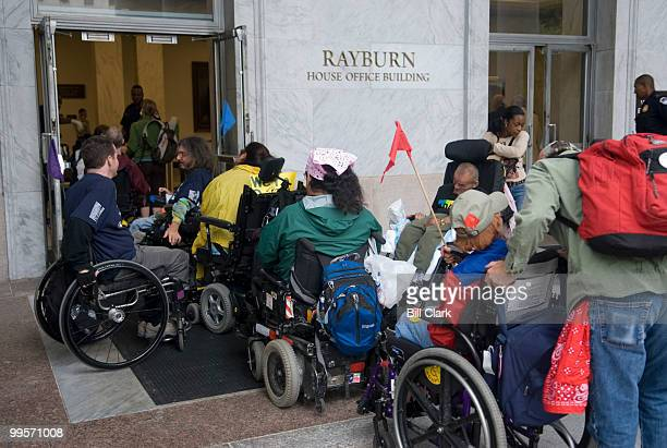 Members of the disabilityrights organization ADAPT wait outside of Rayburn to go through security to attend the House Constitution Subcommittee's...