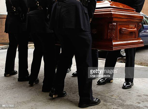 Members of the District of Columbia Metropolitan Police Honor Guard carry Dorothy Height's casket into the back of Howard University's Burr...