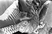 Members of the Dodge City Crips/Second Street Mob in San Pedro Calif pose with a stack of crisp $100 bills in 1987 The gang sold crack cocaine in the...