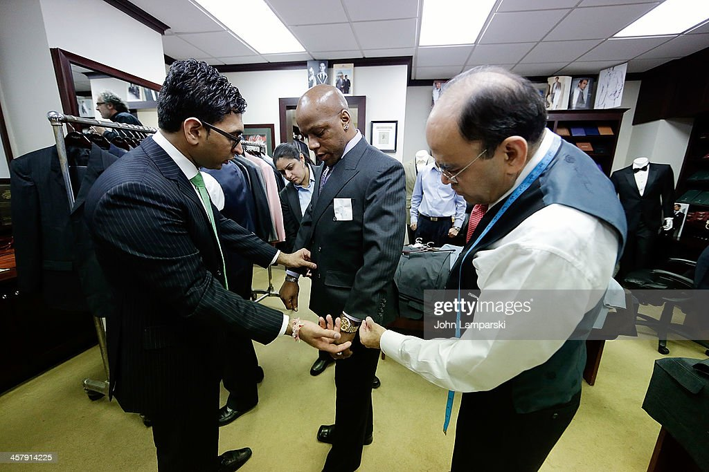 Members of the Doe Fund are fitted with suits by Mohan Ramchandan (r) during the 2013 Mohan's Winter Coat Drive Benefiting The Doe Fund at Mohan's Custum Tailors on December 19, 2013 in New York City.