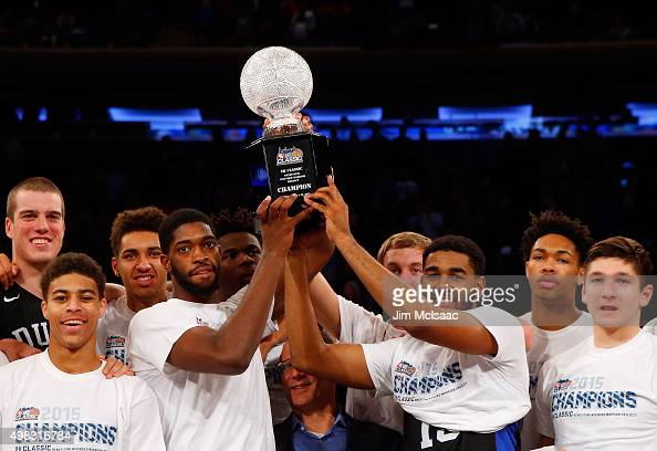 Members of the Duke Blue Devils celebrate with the trophy after defeating the Georgetown Hoyas after the 2K Classic championship game at Madison...