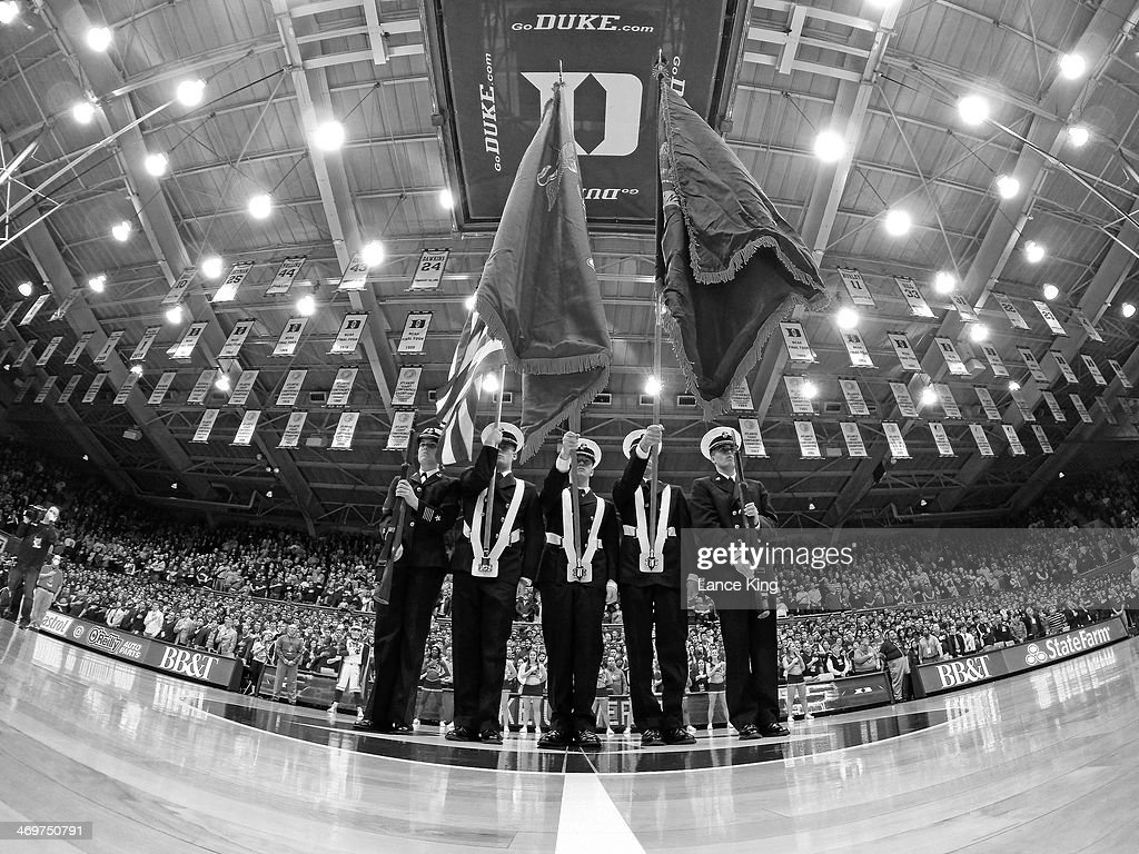 Members of the Duke University Naval ROTC stand at attention during the National Anthem prior to a game between the Maryland Terrapins and the Duke Blue Devils at Cameron Indoor Stadium on February 15, 2014 in Durham, North Carolina. Duke defeated Maryland 69-67.